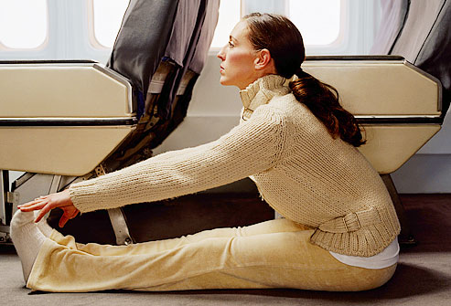 Copy-of-getty_rm_photo_of_woman_stretching_legs_in_plane_aisle